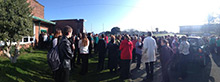 staff and students from Ysgol Bro Gwaun watch the solar eclipse